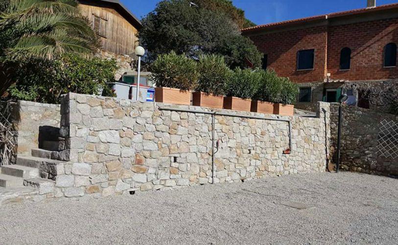 Luca milano edilizia impresa edile isola del giglio for Scala in cemento armato a vista